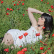 Woman among poppies — Stock Photo