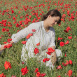 Young girl among poppies — Stock Photo #27639473