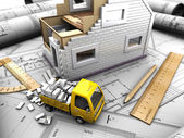Yellow truck and model of house — Stock Photo