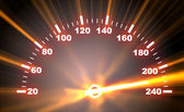 Speedometer on blaze background — Stock Photo