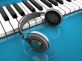 Klaviatur med hörlurar — Stockfoto