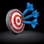 Постер, плакат: Three darts in target