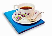 Taza de café o té con un libro — Foto de Stock