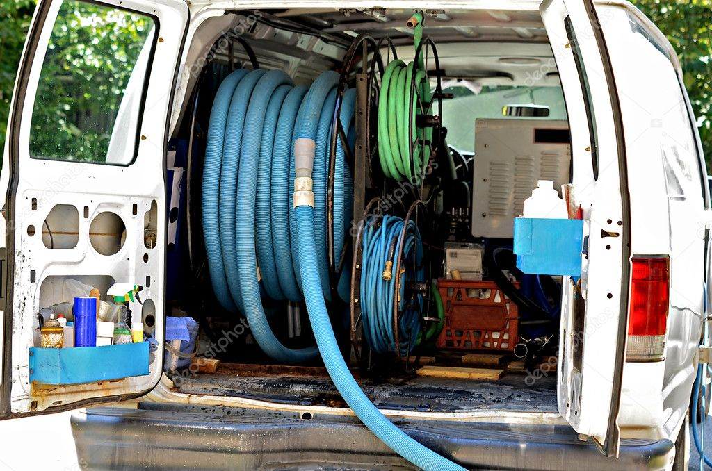 A van with equipment in the back for cleaning carpet. — Stock Photo #12380304