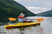 Woman Kayaking in Mountains — Stock Photo