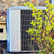 Stock Photo: Air Conditioner / Heating Unit on House