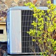 Air Conditioner / Heating Unit on a House - Stock Photo