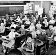Stock Photo: 1959 classroom photo with students at desks.