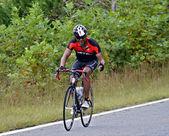 Smiling Man on Bicycle Ride — Stock Photo