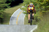 Man Going Downhill on Bicycle — Stock Photo