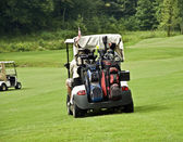 Golfers in Carts — Stock Photo