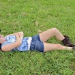 Teenage Girl Lying in Grass — Stock Photo