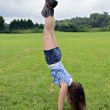 Girl Handstand Outdoors — Stock Photo #29240993