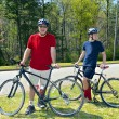 Father and Son Mountain Bikers — Stock Photo #46708535