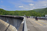 Motorcycles Riding Across Dam — Stock Photo