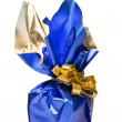 Christmas present in a shiny blue box with gold ribbon at white — Stock Photo #14400555