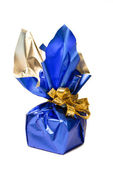 Christmas present in a shiny blue box with gold ribbon at white — Stock Photo