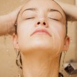 Girl in the shower — Stock Photo
