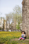 Little girl by the tree — Stock Photo