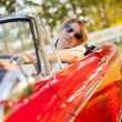 Girl in red cabriolet — Stock Photo