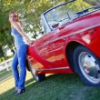 Girl and red cabriolet — Stock Photo