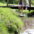 Loving couple on wooden bridge — Stock Photo