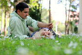 Young couplein the field — Stock Photo