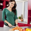 Young woman in the kitchen — Stockfoto