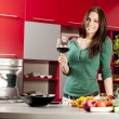 Stock Photo: Young woman in the kitchen