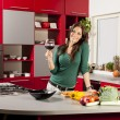 Young woman in the kitchen — Stock Photo #15682173