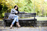 Girl on the bench — Foto de Stock