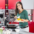 Stock Photo: Young womin kitchen