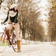 Young woman on the bicycle — Stock Photo #18104013