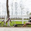 Girl with bicycle — Stock Photo #18104319