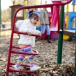 Little girl on the playground — Stock Photo #18104855