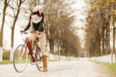 Young woman on the bicycle — Stock Photo
