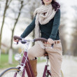 Young woman on the bicycle — Stock Photo #18328643