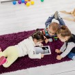 Kids with tablet — Stock Photo #19301887