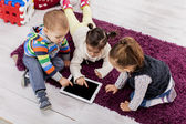 Kids with tablet — Stock Photo