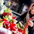 Young woman at the market — Stock Photo #21636909
