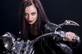 Young woman on the motorcycle — Stock Photo