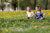 Kids in the spring field — Stock Photo