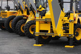 Yellow construction vehicles ready for work — Stock Photo