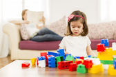 Little girl playing in the room — Stock Photo