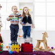 Kids playing in the room — Stockfoto