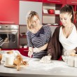 Young women in kitchen — Stok Fotoğraf #25162079