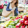 Young woman at the market — Stock Photo