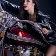 Young woman on the motorcycle - Stock Photo