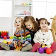 Kids playing in the room — Stockfoto #26161693