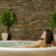 Young womin hot tub — Stock Photo #27096125
